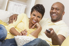 Happy African American Woman Couple Remote Control Stock Photography