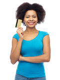 Happy african american woman with credit card Stock Photos