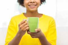 Happy african american woman drinking from tea cup Royalty Free Stock Photos