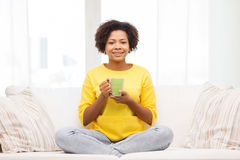 Happy african american woman drinking from tea cup Stock Photography