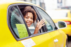 Happy african american woman driving in taxi Royalty Free Stock Photos