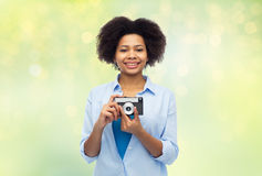 Happy african american woman with film camera Royalty Free Stock Photos