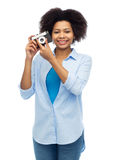 Happy african american woman with film camera Royalty Free Stock Photo