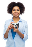 Happy african american woman with film camera Royalty Free Stock Photography