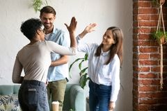 Happy African American woman giving high five with friend royalty free stock photography