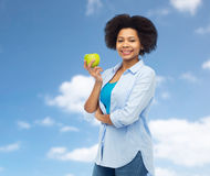 Happy african american woman with green apple Stock Photography