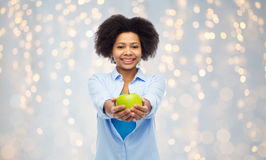 Happy african american woman with green apple Royalty Free Stock Photo
