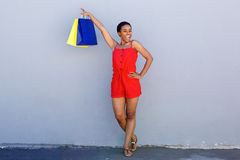 Happy african american woman holding shopping bags Stock Photo