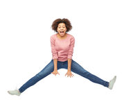 Happy african american woman jumping over white Stock Photography