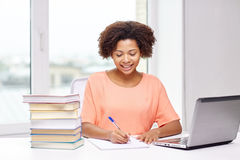 Happy african american woman with laptop at home Royalty Free Stock Image
