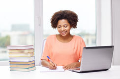 Happy african american woman with laptop at home Royalty Free Stock Photos
