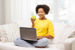 Happy african american woman with laptop at home Stock Photography