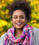Happy african american woman laughing outside Royalty Free Stock Photo