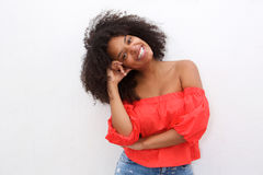 Happy african american woman leaning with head on hand Stock Photos