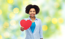 Happy african american woman with red heart shape Royalty Free Stock Photos