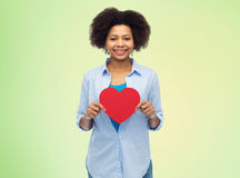 Happy african american woman with red heart shape Royalty Free Stock Image