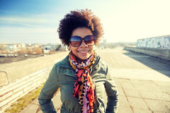 Happy african american woman in shades on street Stock Photos