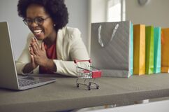 Free Happy African American Woman Shopping Online Via Laptop Rejoice Sale Offer Royalty Free Stock Image - 217681626
