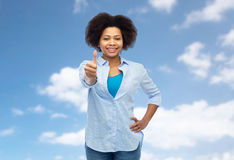 Happy african american woman showing thumbs up Stock Images