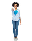 Happy african american woman showing thumbs up Stock Photos