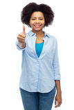 Happy african american woman showing thumbs up Stock Image