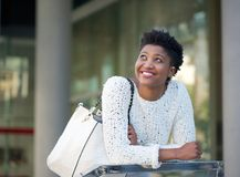 Happy african american woman smiling in the city Stock Photography