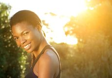 Happy african american woman smiling outdoors Stock Photos