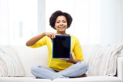 Happy african american woman with tablet pc Stock Photography