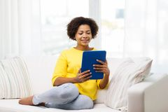 Happy african american woman with tablet pc Stock Photo