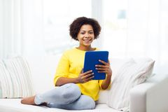 Happy african american woman with tablet pc Royalty Free Stock Photography