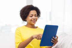 Happy african american woman with tablet pc Royalty Free Stock Images