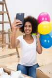Happy African American woman taking a selfie Royalty Free Stock Images