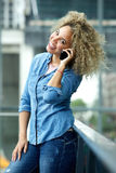 Happy african american woman talking on phone Stock Photos