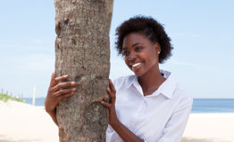 Happy african american woman with a tree Stock Photography