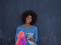 Happy African American Woman Using Digital Tablet Stock Photo
