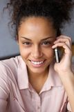 Happy african american woman using mobile phone Royalty Free Stock Photo