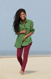 Happy african american woman walking on the beach Stock Photos