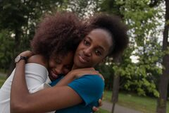 Free Happy African American Women Cuddle, Friends Royalty Free Stock Photos - 196719178