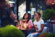 Free Happy African American Women, Friends Sitting Together At The Outdoor Restaurant At Summer Day Royalty Free Stock Photo - 198922135
