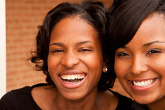 Happy African American women laughing and smiling. Royalty Free Stock Photo