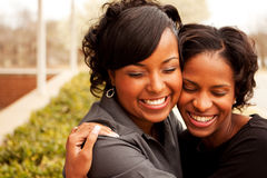 Happy African American women laughing and smiling. Happy African American friends laughing and smiling Royalty Free Stock Photo