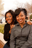 Happy African American women laughing and smiling. Stock Images