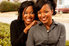 Happy African American women laughing and smiling. Happy African American friends laughing and smiling Royalty Free Stock Images