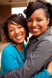 Happy African American women laughing and smiling. Stock Image