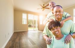 Happy African American Young Family In Empty Room of House. Happy African American Young Family In Empty Room of a New House stock image