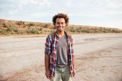 Happy african american young man with backpack Royalty Free Stock Image
