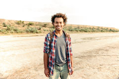 Happy african american young man with backpack Royalty Free Stock Images
