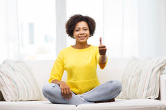 Happy african american young woman at home Stock Photo