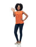 Happy african american young woman over white. People, race, ethnicity, gesture and portrait concept - happy african american young woman showing ok hand sign Stock Photos