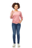 Happy african american young woman showing ok sign Stock Photos